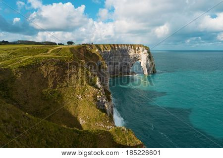 Cliffs and natural arch Etretat France Europe. Beautiful european landscape. Popular landmark famous destination of Normandy