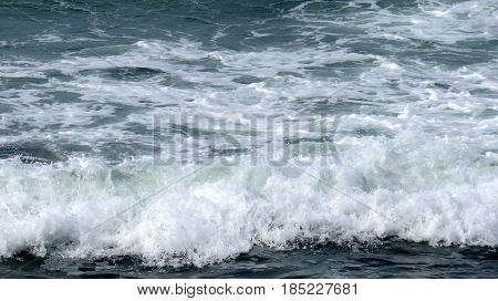 Tidal waves rolling in at San Diego shore