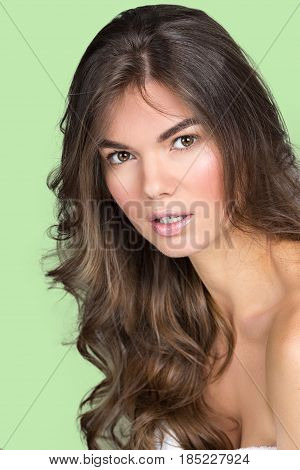 Studio portrait of a pretty woman with wavy fair hair and natural make-up