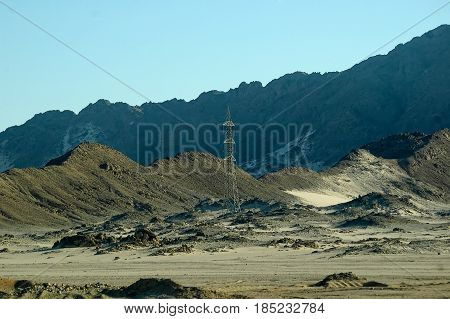 Electricity tower in desert on the Red sea governorate, Egypt. Africa