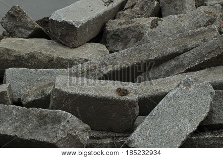 Old cuboid stone- background/ Old cuboid stone in heap.