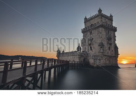 Belem Tower long exposure at beautiful sunset.Tower of St Vincent on the bank of the Tagus River in Belem district,Lisbon,Portugal.Travel and explore the world concept.Sunset in the world
