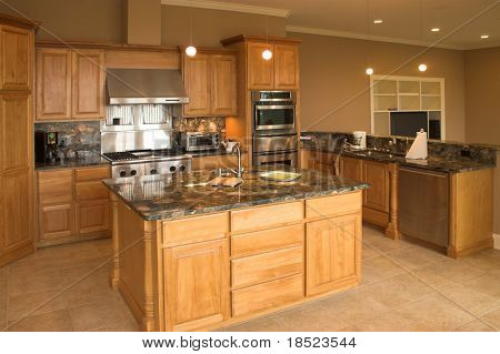 Expensive kitchen with granite counters and tile floor