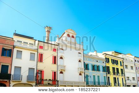 row of Italian residential buildings colorful blue sky european flat colorful terraced houses historic
