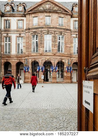STRASBOURG FRANCE - MAY 7 2017: French city-hall with people heading to vote during the second round of the French presidential election to choose between Emmanuel Macron and Marine Le Pen