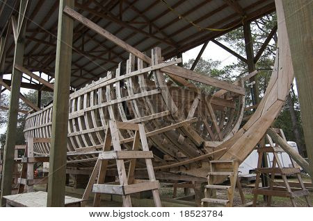 wooden ship in drydock under construction