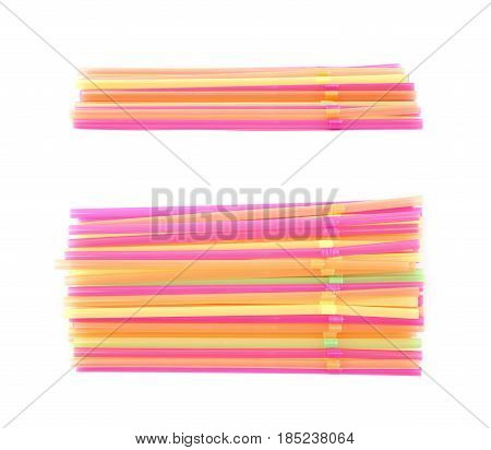 Big pile of colorful plastic drinking straws isolated over the white background, set of two different foreshortenings
