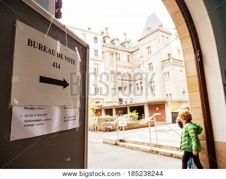 STRASBOURG FRANCE - MAY 7 2017: Bureau de vote sign in French city with kids playing near pooling place during the second round of the French presidential election to choose between Emmanuel Macron and Marine Le Pen