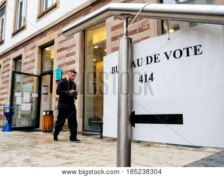 STRASBOURG FRANCE - MAY 7 2017: French city with people man leaving polling place during the second round of the French presidential election to choose between Emmanuel Macron and Marine Le Pen