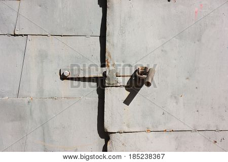 Castle on Grunge gray metal pieces of iron plates doors