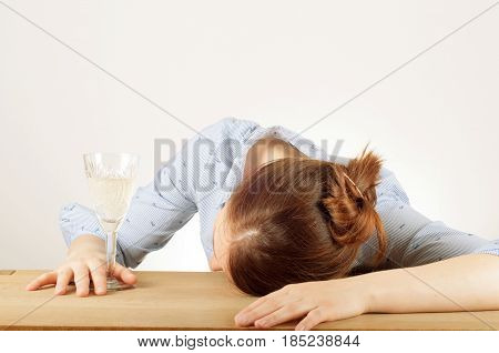 Young woman drinking champagne with a feeling of despair. Addicted to alcohol alcoholism concept social problem
