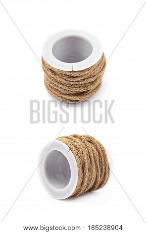 Decorational rope string on a bobbin isolated over the white background, set of two different foreshortenings