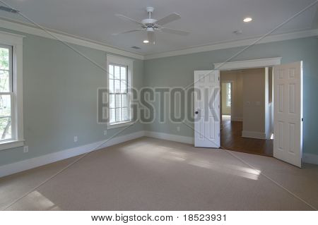 unfurnished bedroom suite with double doors