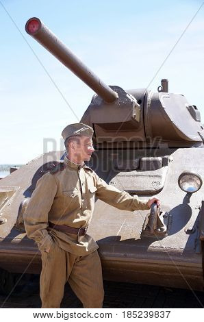 Fighter of Red Army in the form of times of World War II at the T-34 tank