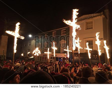 Lewes England - 5 November 2016: Dark and crowded streets of Lewes for the fire parade of the yearly celebration of the Bonfire night festivities.