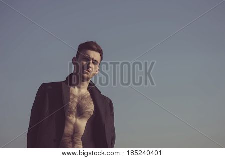 Handsome Man Posing In Unbutton Coat With Hairy, Naked Torso