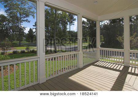 screened-in porch with view of park
