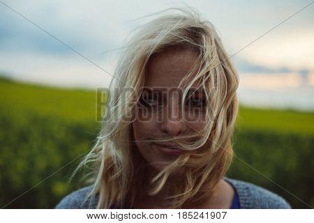 Woman portrait in windy weather