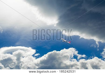 Riven heavens and lonely airplane over Black Sea on a fall season.