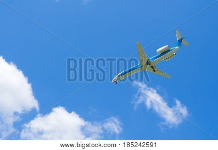 Blue sky white clouds and airplane .