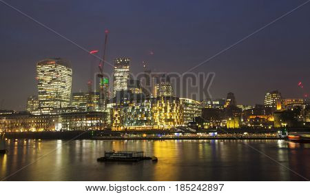 London, UK - 23 January 2017:  Night view of Canary Wharf, a major business district located in London, UK. It's a home to the headquarters of numerous major banks and other professional service firms