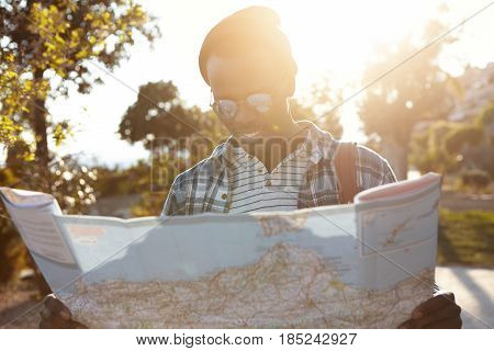 People, Lifestyle, Travel And Tourism Concept. Handsome Cheerful Young Black European Man Holding Pa