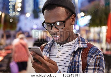 Attractive Young Dark-skinned European Hitchhiker With Knapsack Wearing Trendy Glasses And Hat Study