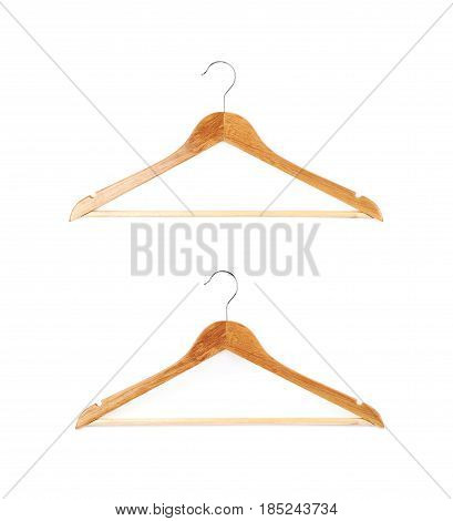 Single white wooden hanger isolated over a white background