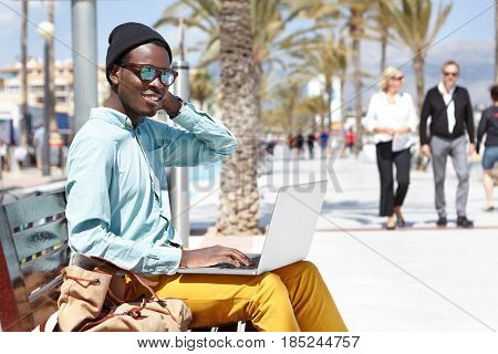People, Modern Technology And Communication Concept. Good Looking Young African Man Spending Great T