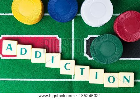 Gambling addiction abstract concept. Letter tiles with casino chips.