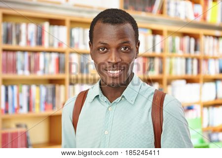 People, Knowledge And Education Concept. Attractive Young Afro American Male With Knapsack Came To B