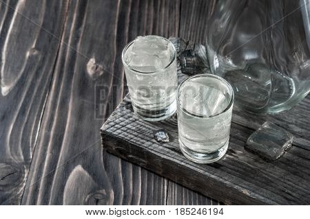 Two Shot Glasses With Cold Vodka On Wooden Table, Selective Focus
