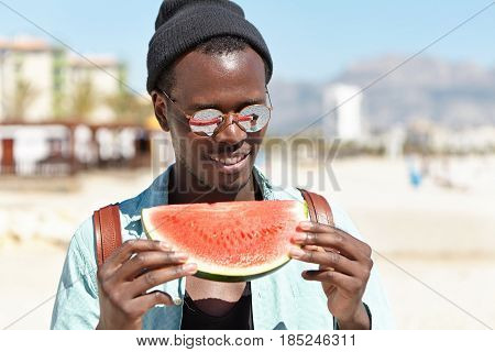 Summer, Recreation, Leisure And Vacations Concept. Handsome African American Male In Fashionable Clo