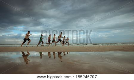20 August 2016, MuiNe, VietNam, Group of young people runs at the beach