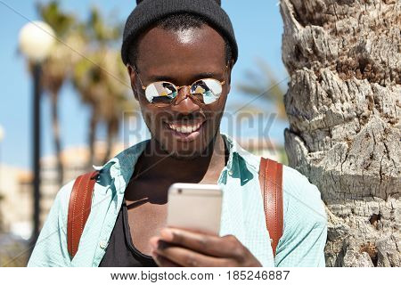 Modern Technology, Communication And People. Happy African American Male Wearing Stylish Eyeglasses