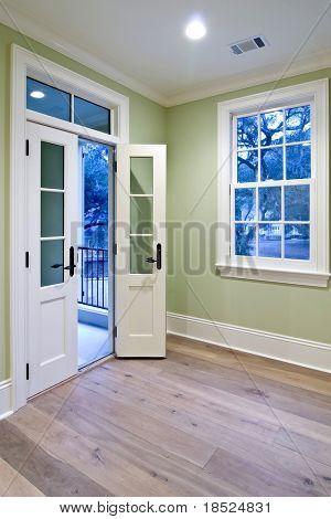 bedroom with double doors open to porch
