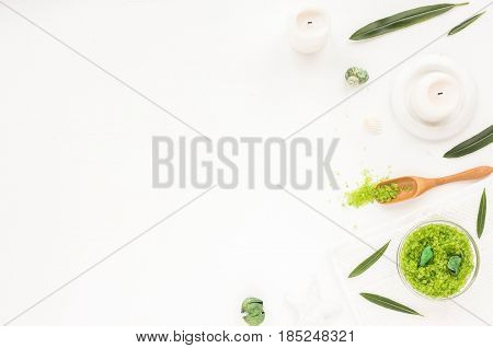 Spa Composition. Candles, Green Leaves, Flowers, Green Sea Salt On White Background. Flat Lay, Mock