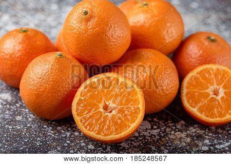 tangerines peeled tangerine and tangerine slices. Pile of fresh organic orange Mandarines or tangerines