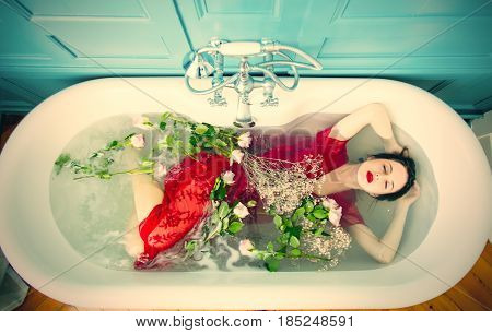 Young Woman In Bath With Flowers