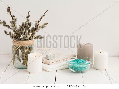 Spa Compositiion. Sea Salt, Towel, Sea Salt, Candles, Willow Brancher On White Wooden Background