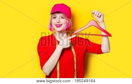 Young Woman With Centimeter And Hanger