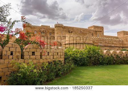 Jaisalmer, India - March 13, 2016: Modern hotel near Jaisalmer that looks like Jaisalmer fort, India.