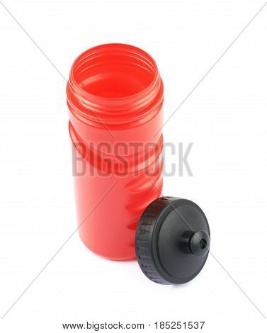 Red plastic sport water bottle isolated over the white background
