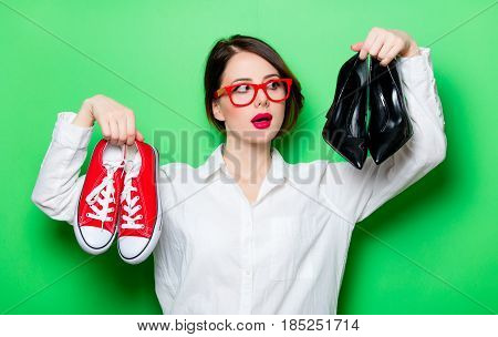 Young Woman With Shoes And Gumshoes