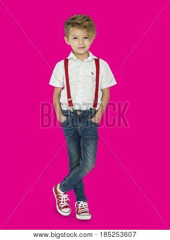 A Caucasian Boy Standing Crossing Legs Background Studio Portrait