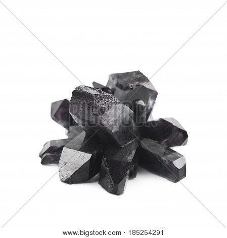 Grown crystal of black colored salt isolated over the white background
