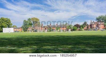 Hartley Wintney, UK. 7th May 2017. Village cricket is being played on the green at Hartley Wintney in north Hampshire on a sunny spring day.