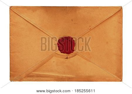 Old vintage yellow paper blank mailing envelope with retro styled red wax seal close up elevated top view