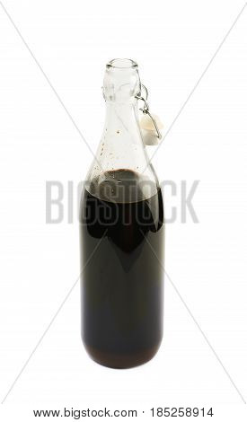 Glass bottle with the wired ceramic cap and filled with the coffee liquor liquid, composition isolated over the white background
