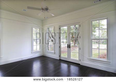empty dining or bedroom with door to yard.